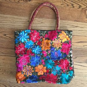 Embroidered multi floral tote bag.